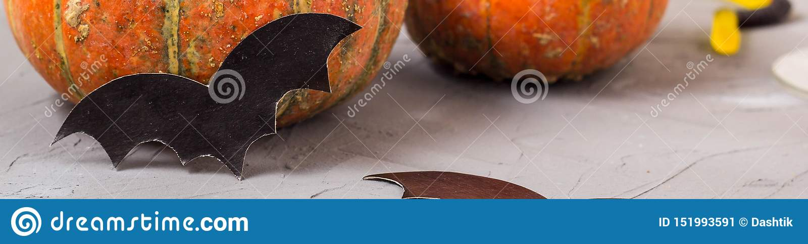 Banner of orange pumpkin and paper bats on white table, halloween concept