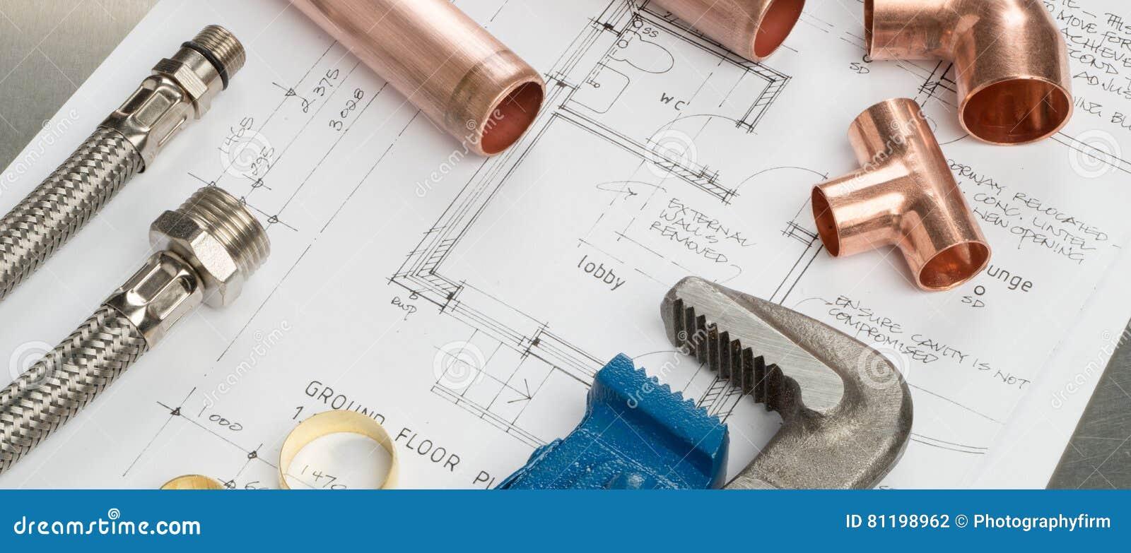 Bannière d outils de plombiers et de matériaux de tuyauterie sur des plans de chambre photo