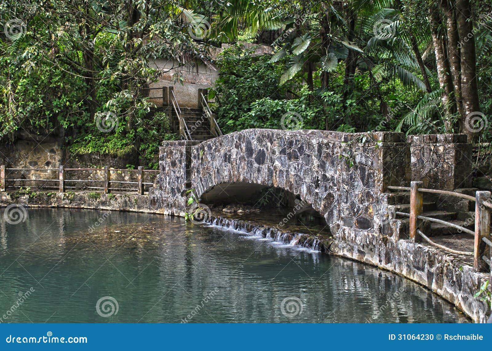 Bano grande pool stone bridge stock photo image 31064230 for Bano grande puerto rico