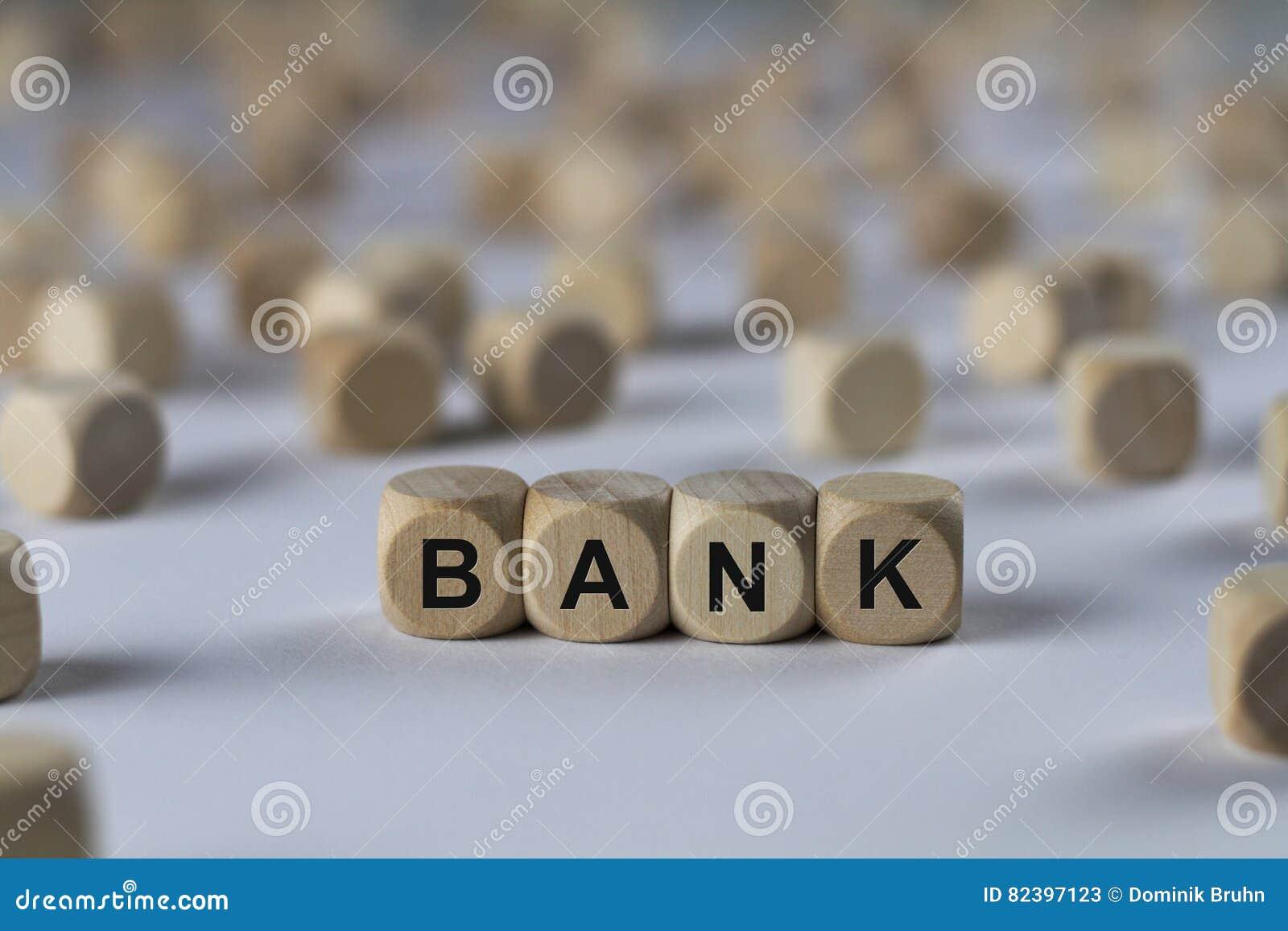 Banque - cube avec des lettres, signe avec les cubes en bois