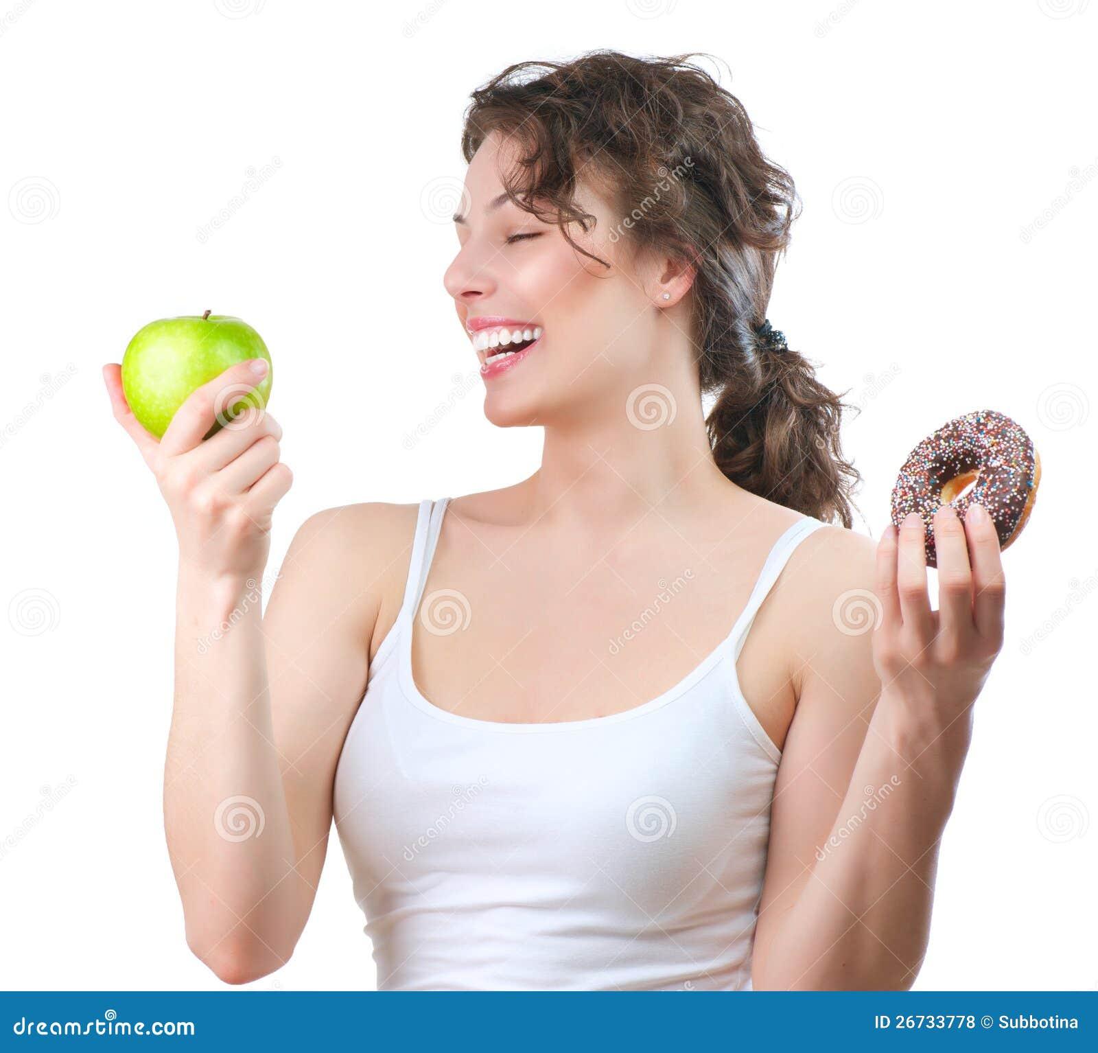 Banta. Ung kvinna som väljer mellan frukt och munken