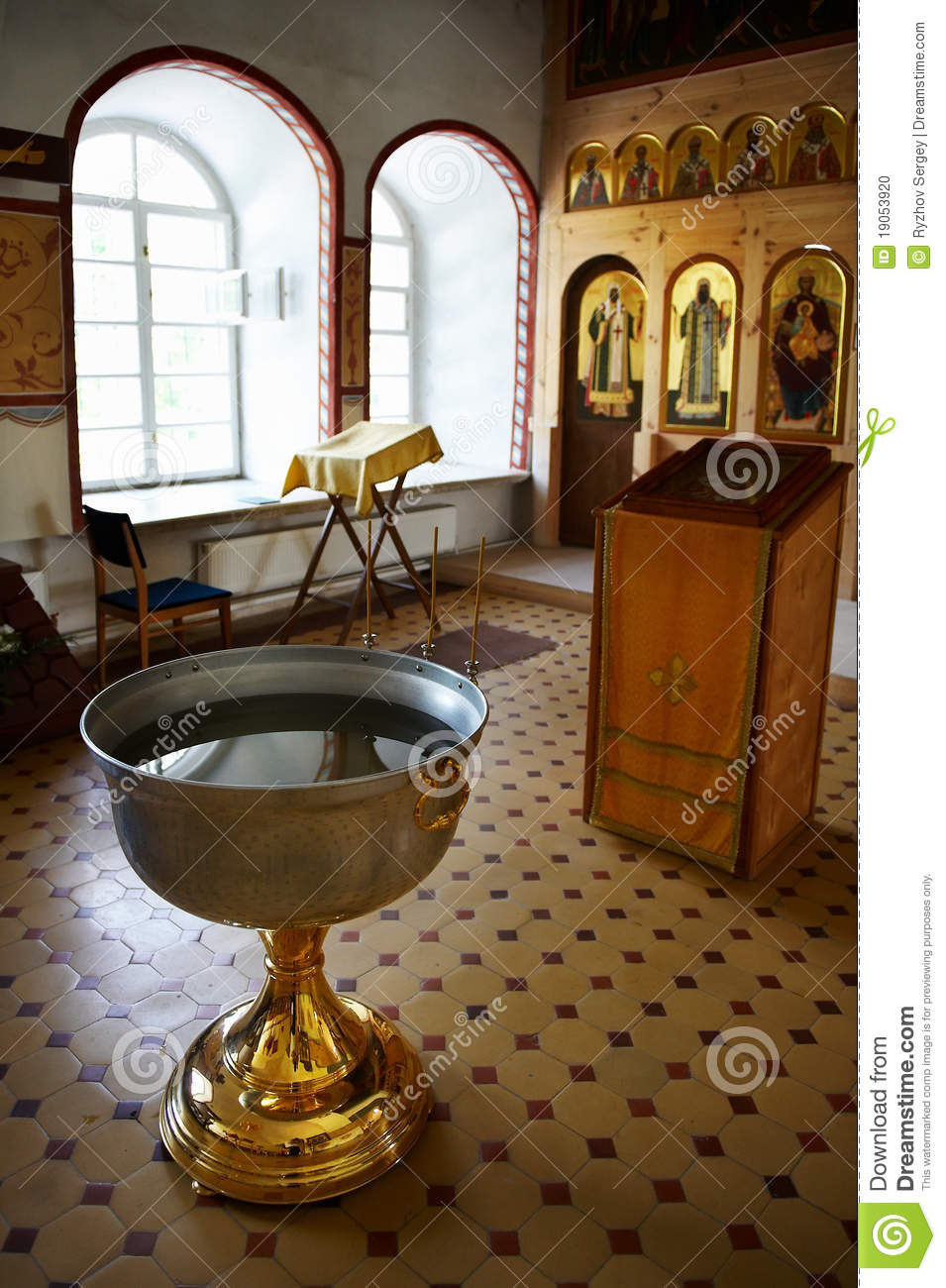 Baptismal Font Of Holy Water Near Altar Stock Photo