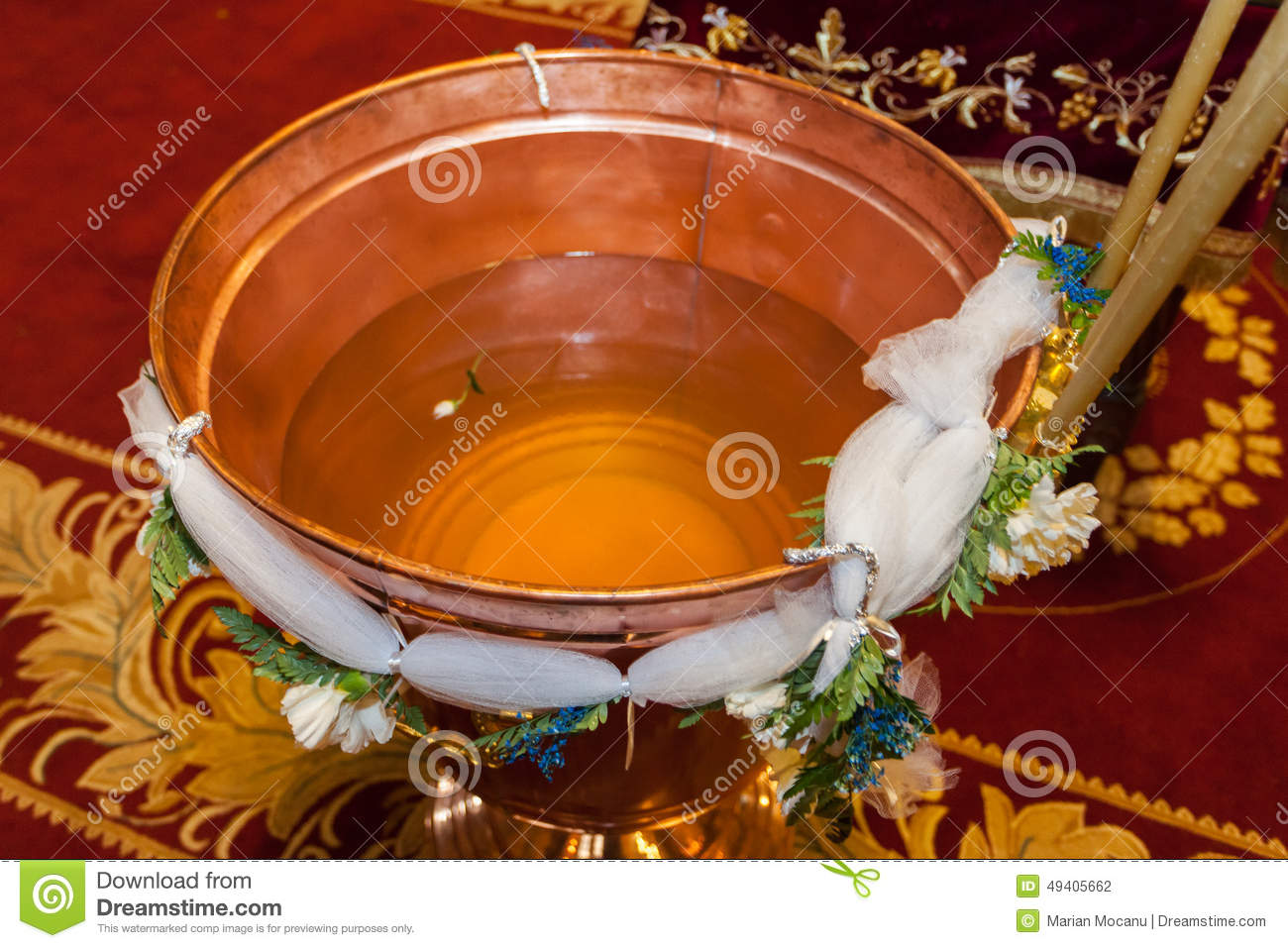 Baptismal font of holy water