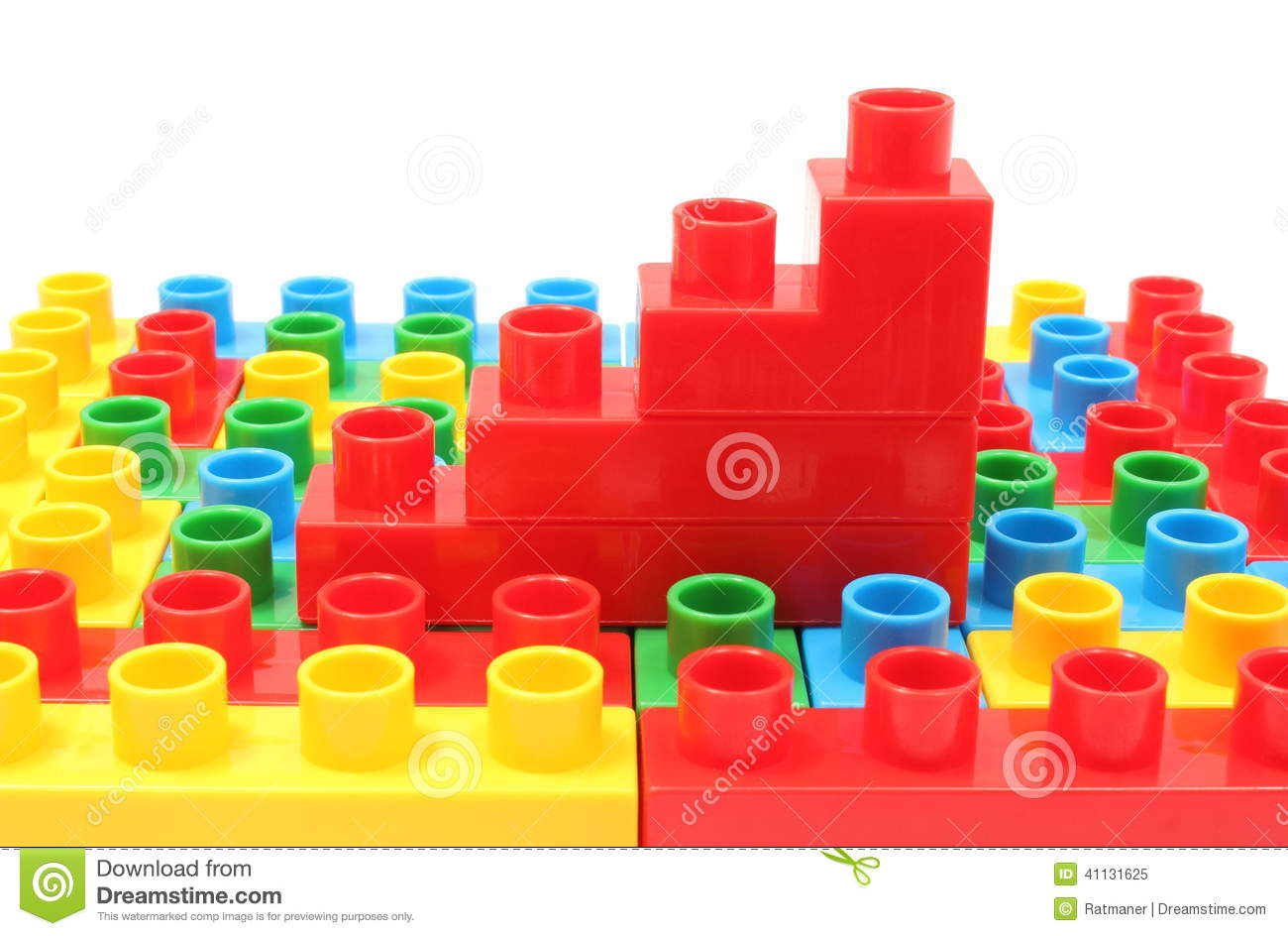 Bar chart of plastic cubes on colorful building blocks
