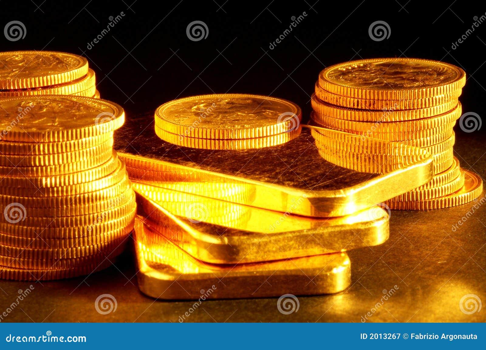 Bar et pièces de monnaie d or