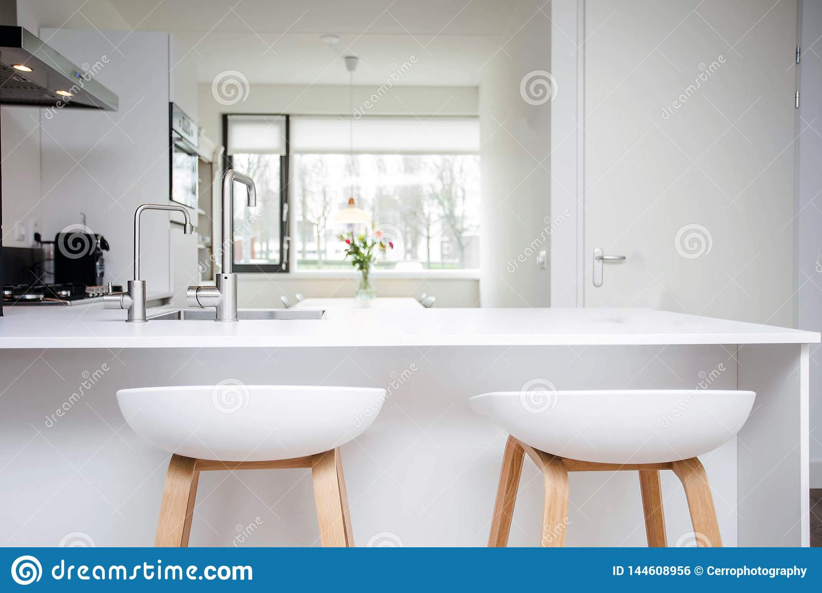 Image of: Bar Stools By Modern White Kitchen Island New And Clean Modern Design Stock Photo Image Of Kitchen Clean 144608956