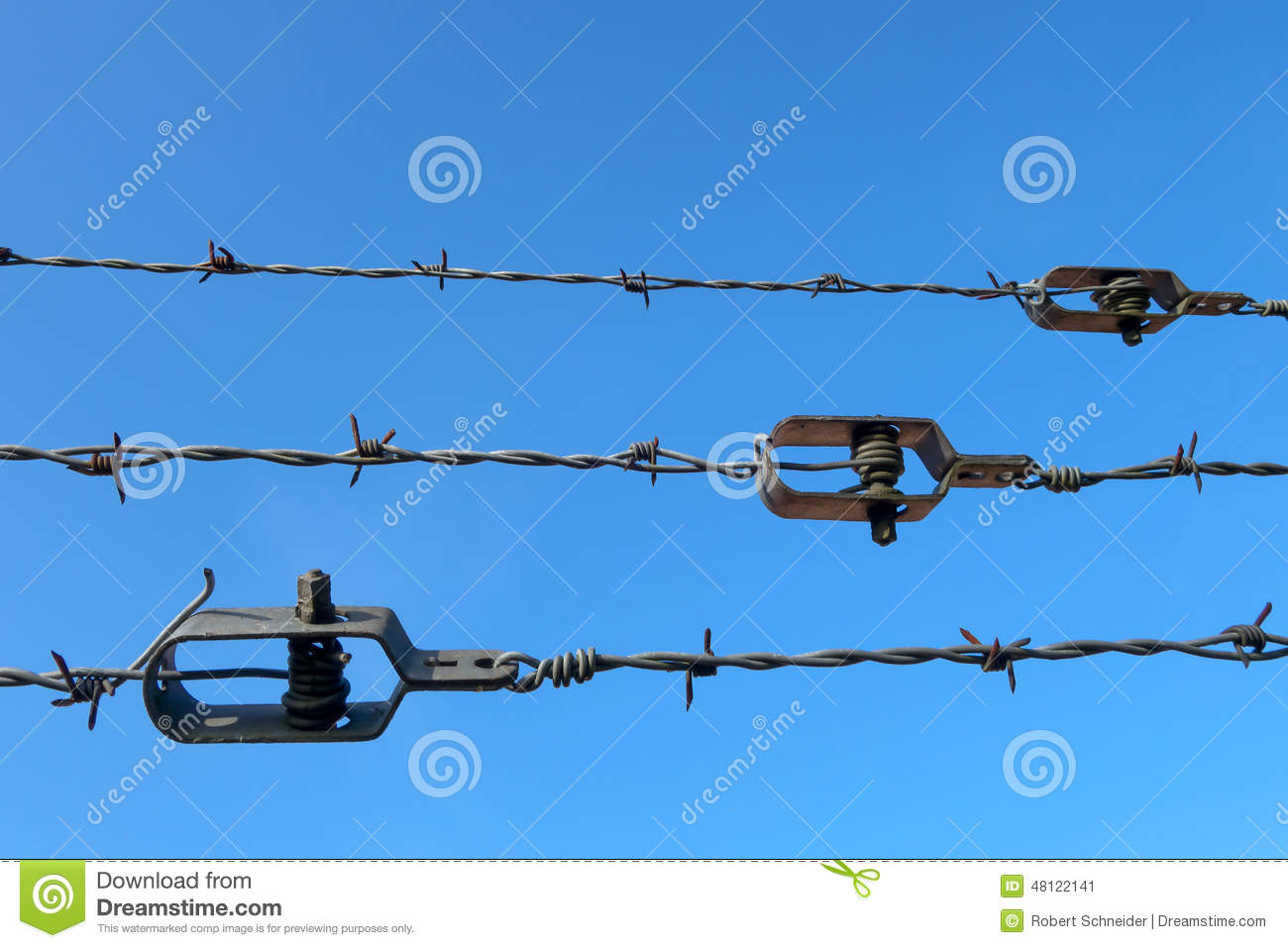 Barb wire with tightener stock image of