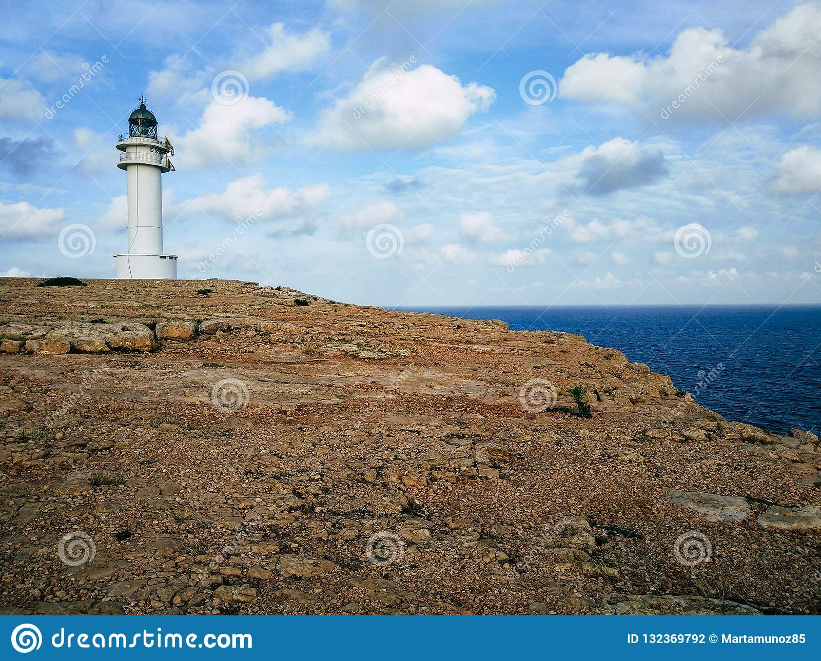 Barbaria Lighthouse at the top of a cliff