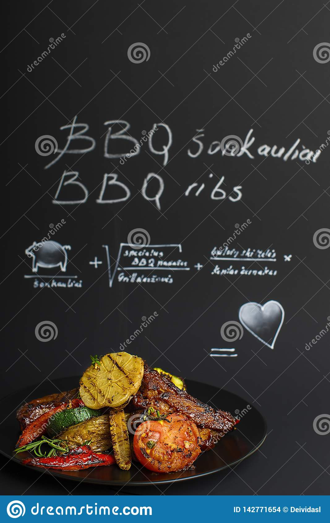 Barbecue ribs on a black background in a studio.