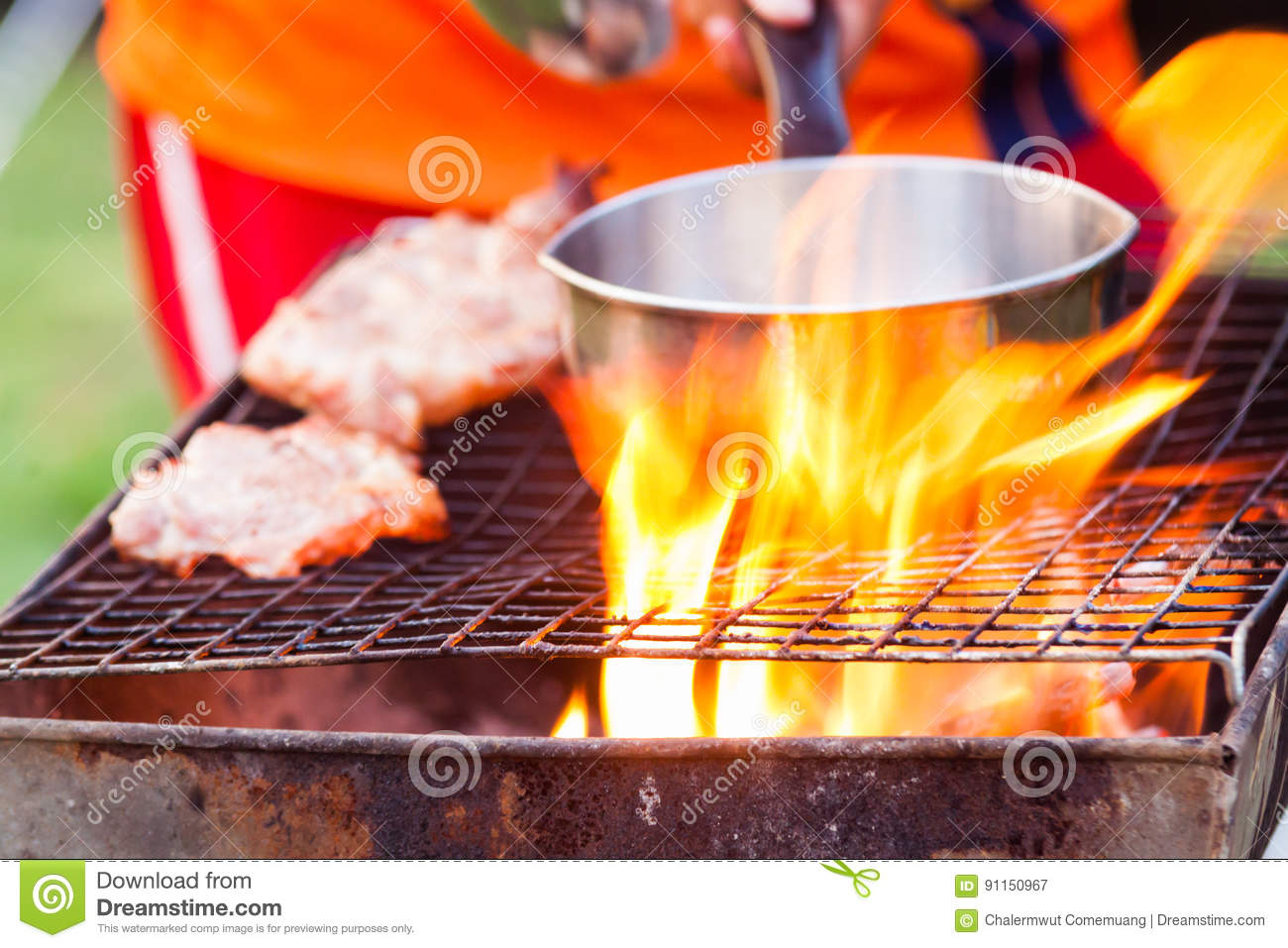 Barbecue in a simple way in wild, collect stones as grill