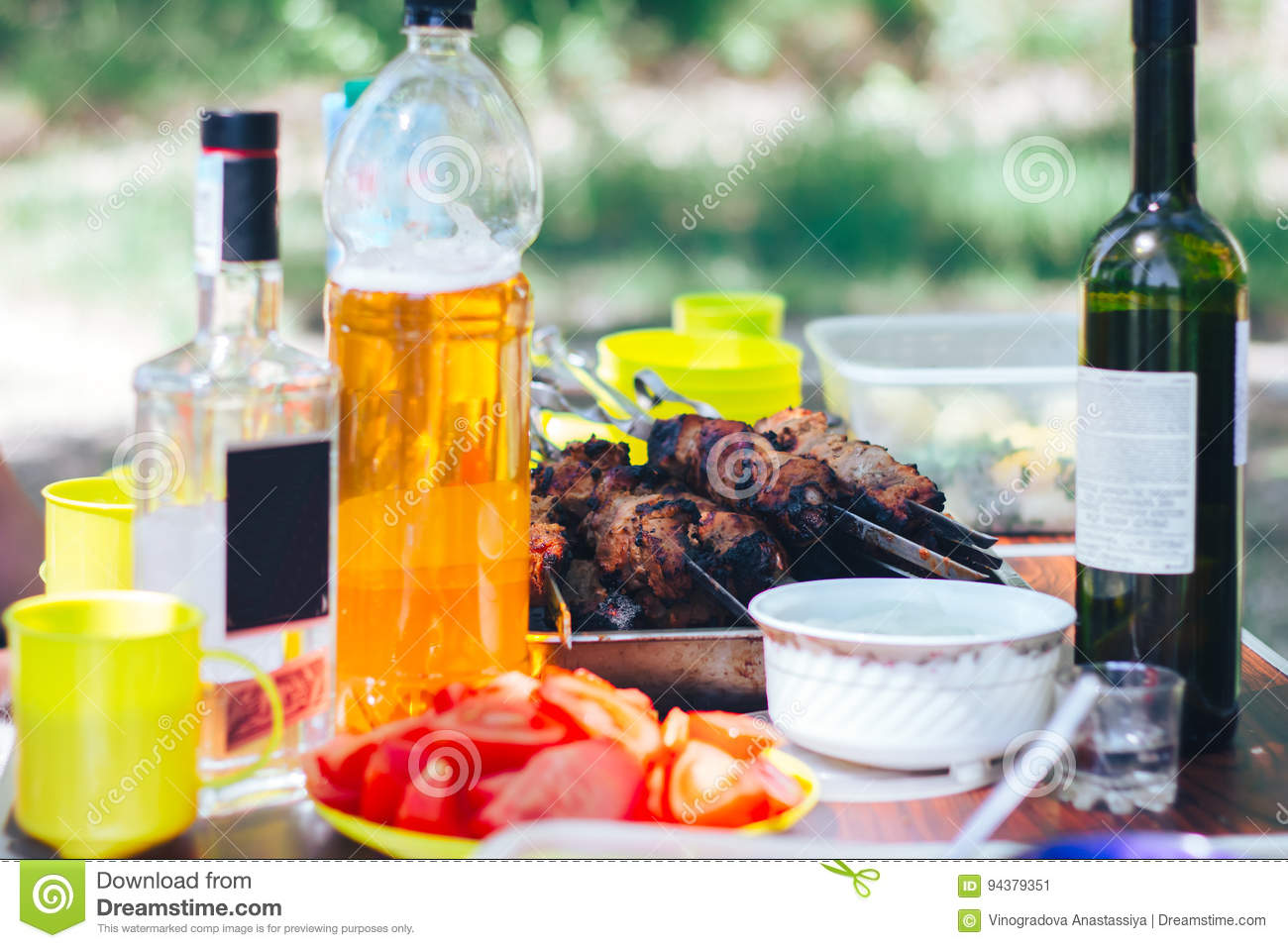 Barbecue on table with wine beer nature