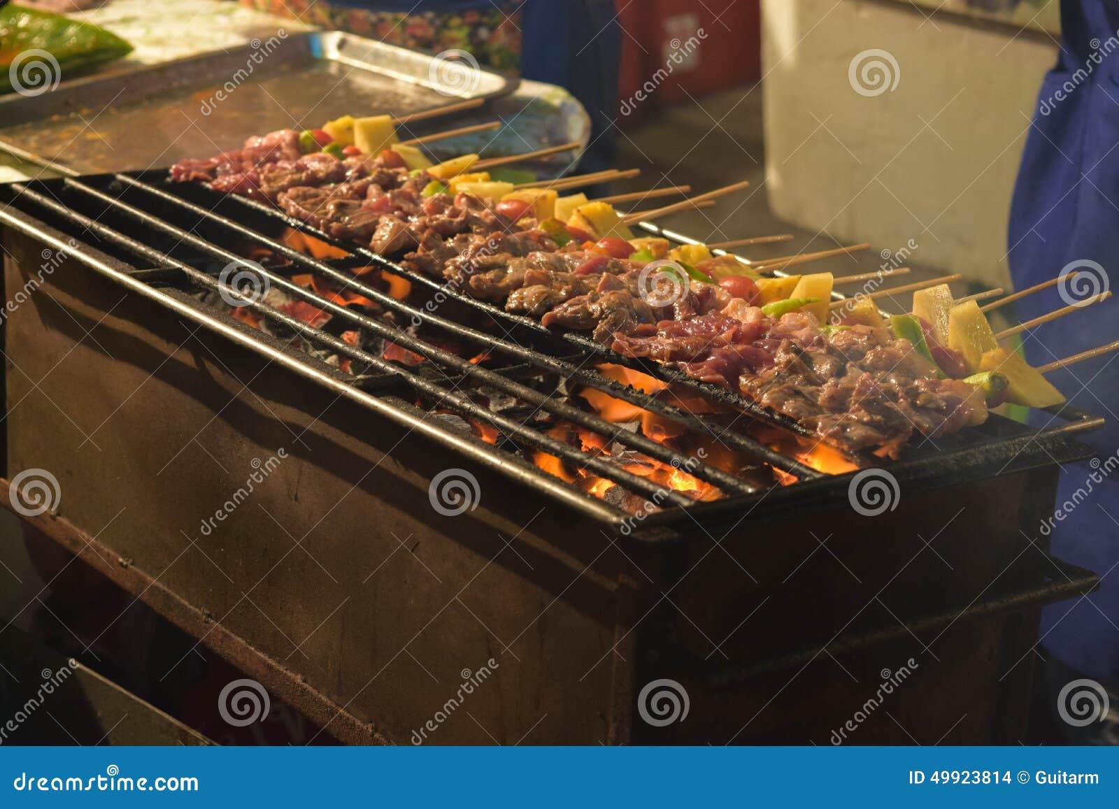 grilling shashlik on barbecue grill selective focus stock. Black Bedroom Furniture Sets. Home Design Ideas
