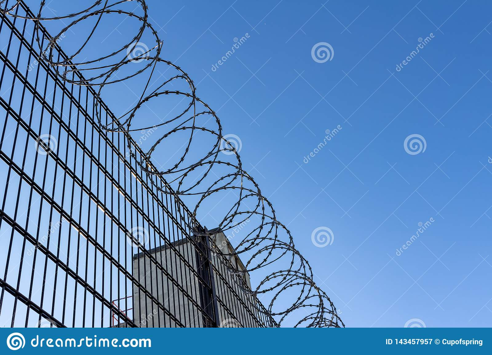 Barbed wire on blue sky background - Lost freedom and hope concept