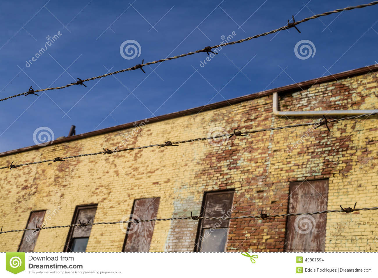 Grunge Background With Barbed Wire Fence Stock Photography