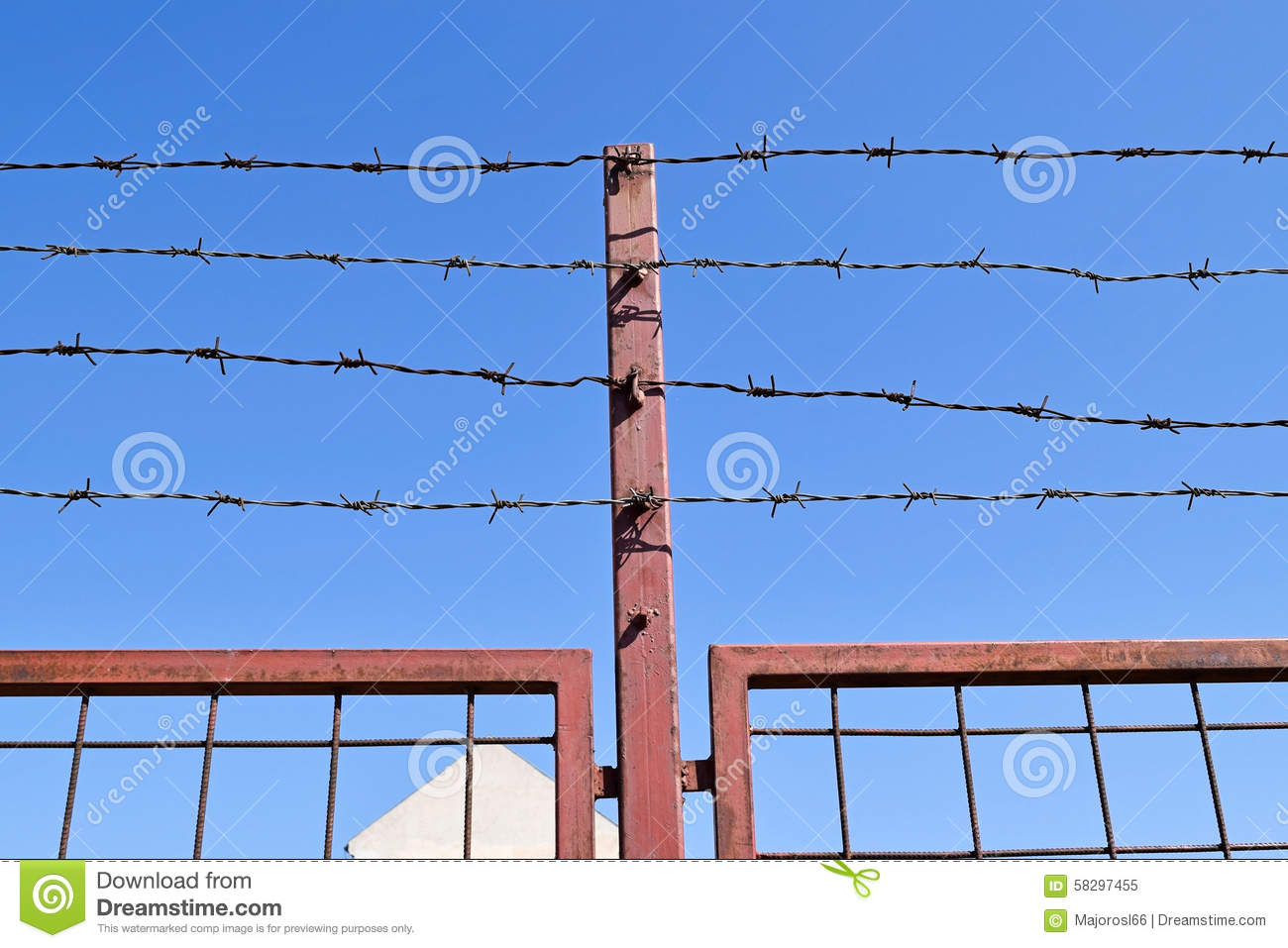 Barbed wire and chainlink fence royalty free stock image