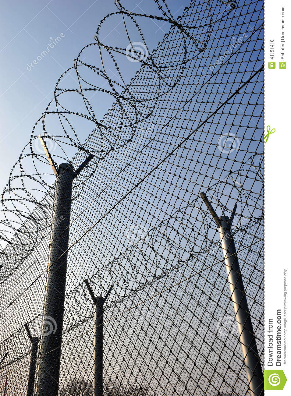 A Barbed Wire Fence With Razor Sharp Wires Stock Photo - Image of ...