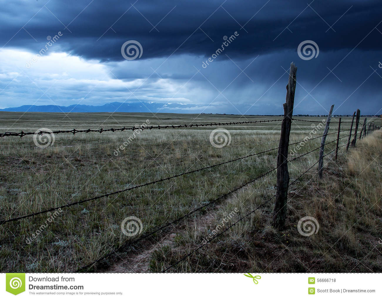 Barbed Wire Fence In A Storm Stock Photo - Image of prairie, meadow ...