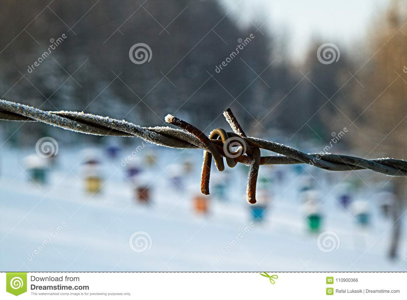 Barbed wire with colorful background