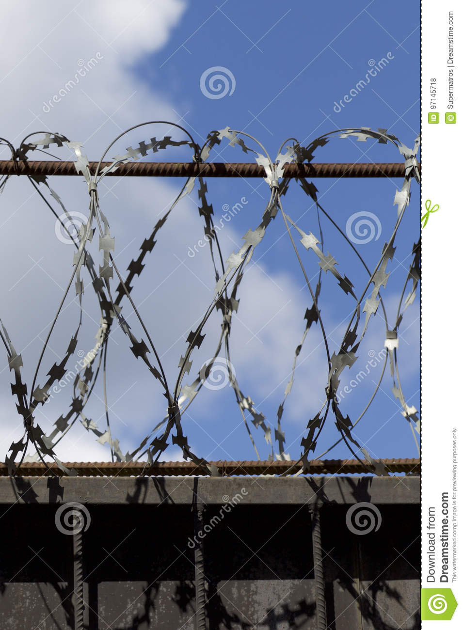 Barbed Wire Wound To The Top Of A Fence Stock Photo - Image: 97145718