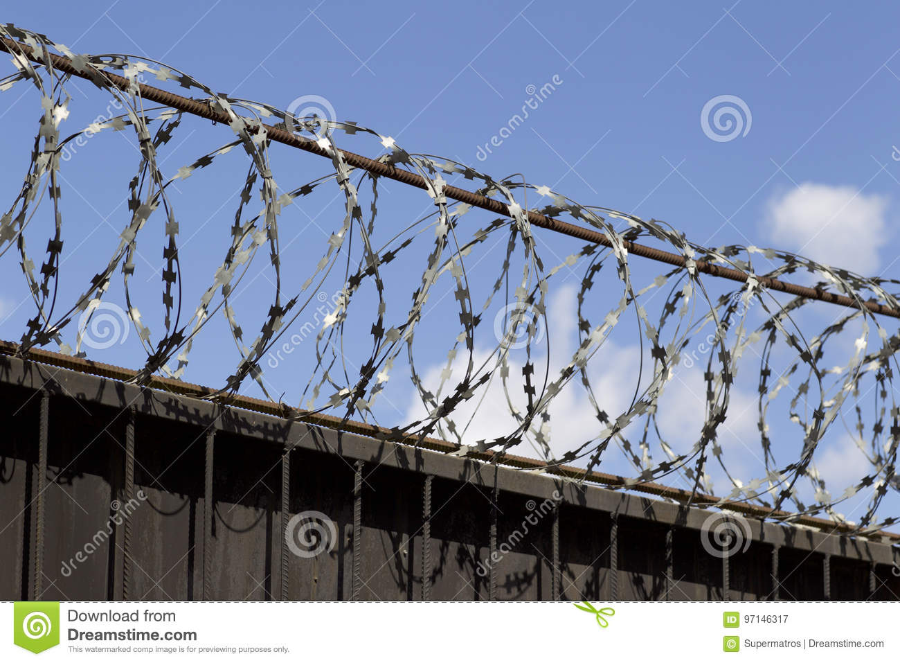 Barbed Wire Wound To The Top Of A Fence Stock Image - Image of ...