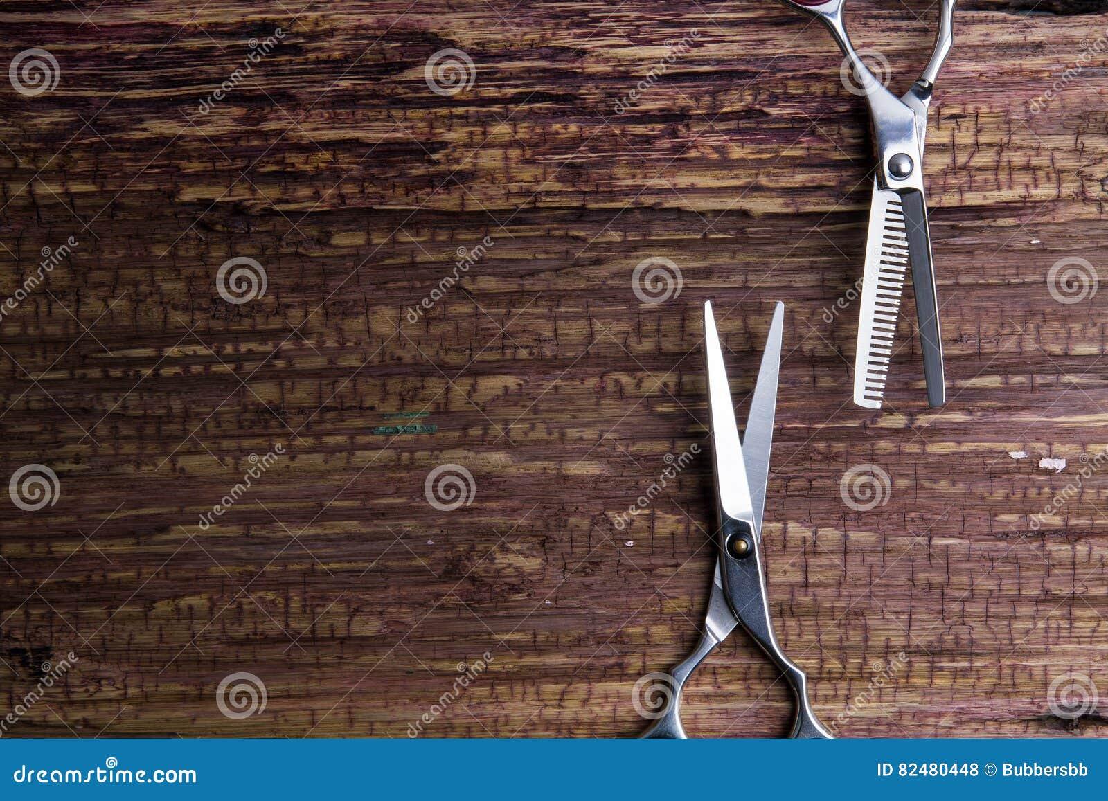Barbeiro e salão de beleza profissionais à moda, tesouras do cabelo, C.A. do corte de cabelo