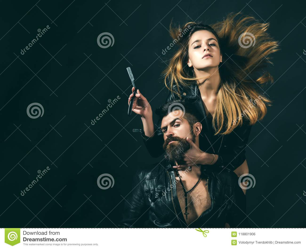 Barber concept. Couple of girl and brutal bearded hipster with mustache, black background. Barber with straight