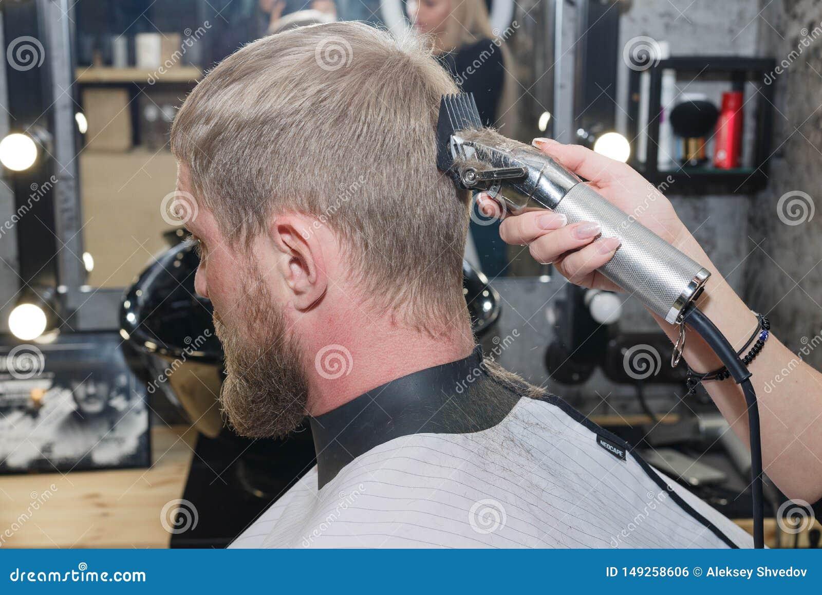 Barber Hair Cutting Machine. The Master Provides A Haircut ...