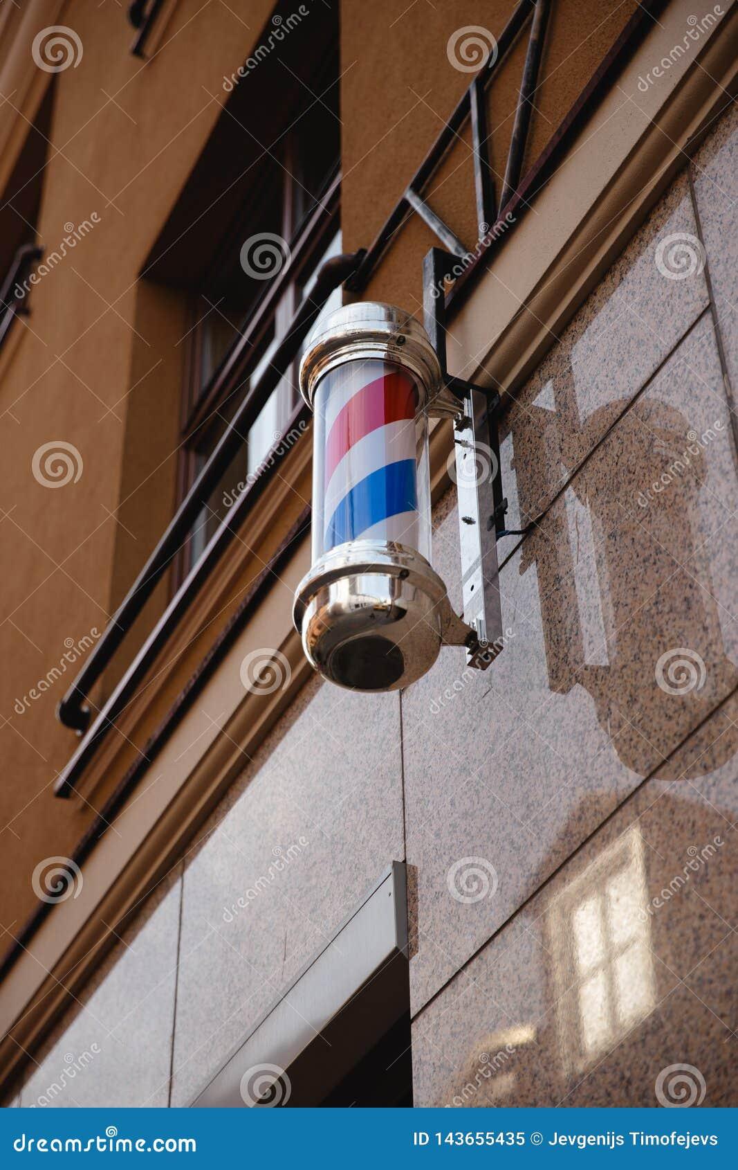 Barberarepolen shoppar Symbol av ett frisersalonglamptecken