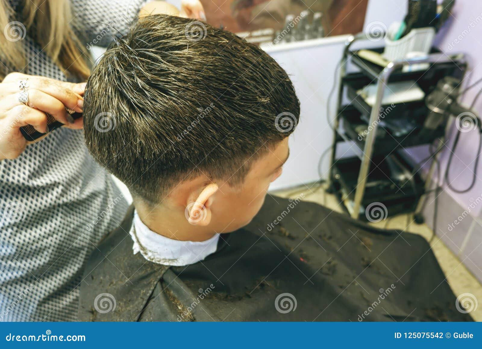 Barbershop Close Up Of Haircuts Teenager Master Does The Hair