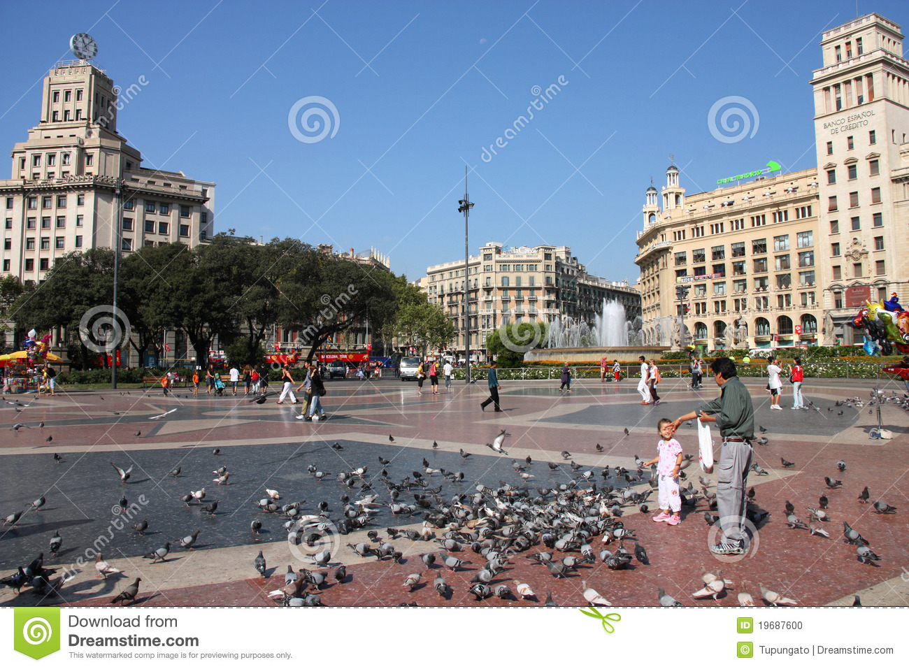 BARCELONA - SEPTEMBER 12: Feeding pigeons on September 12, 2009 at ...