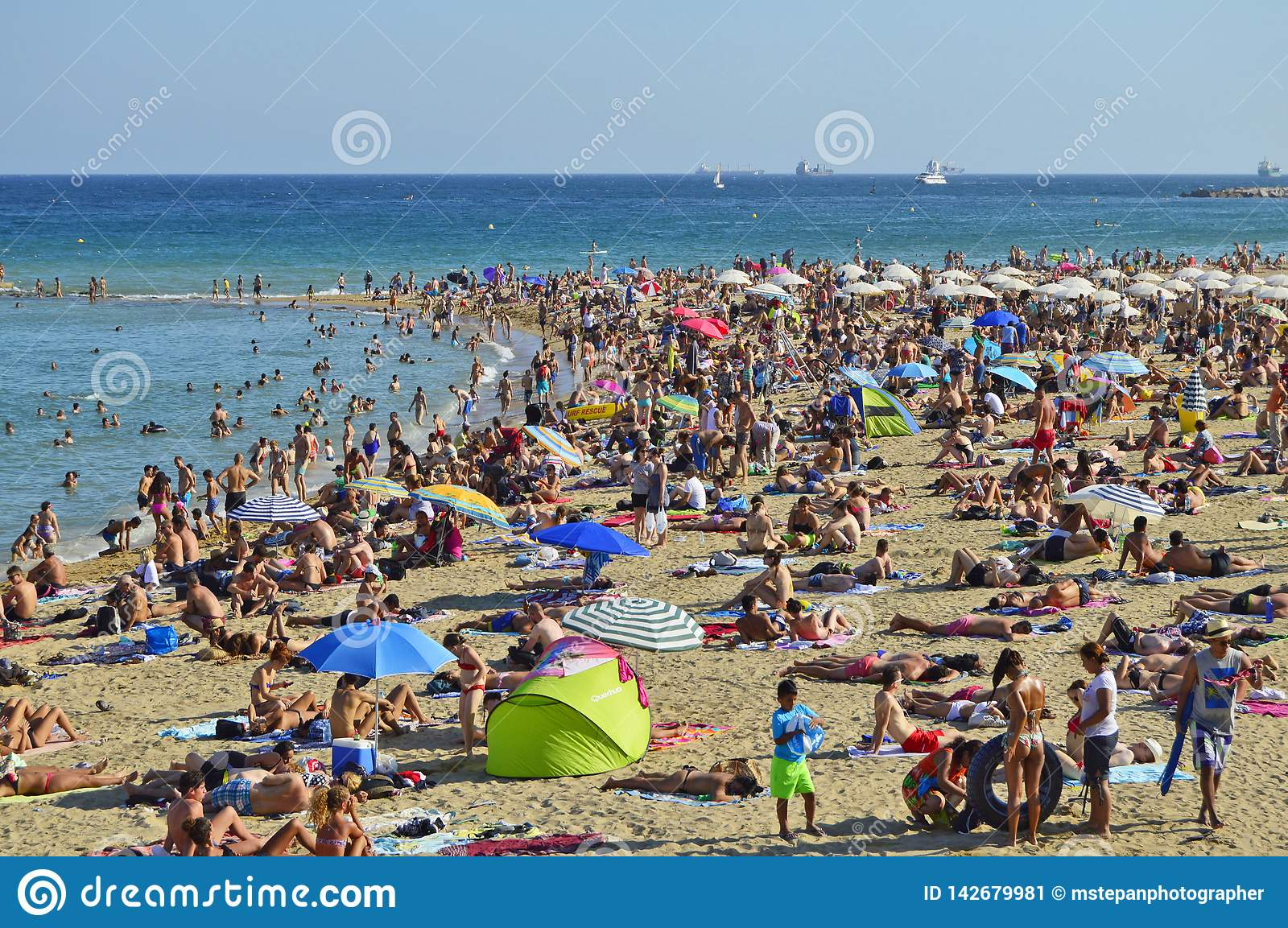 Hot weather people on the beach in Barcelona Spain