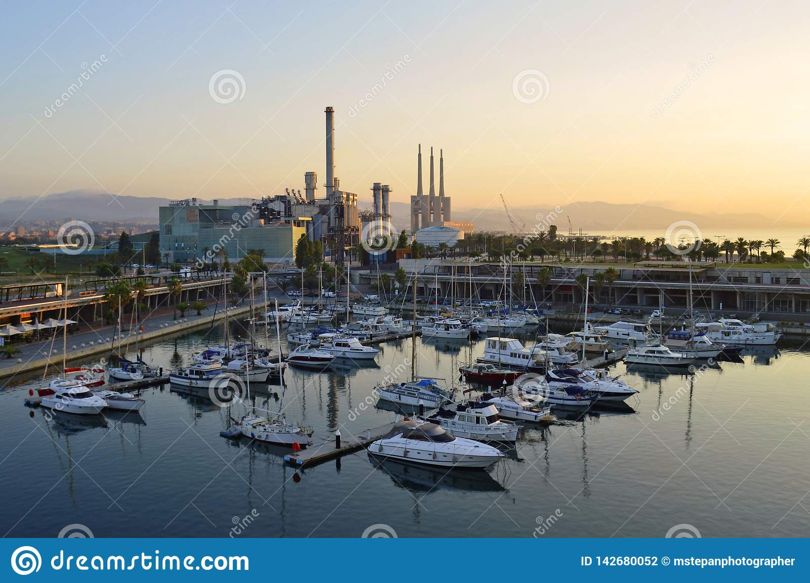 Morning harbor and industrial towers Barcelona Spain