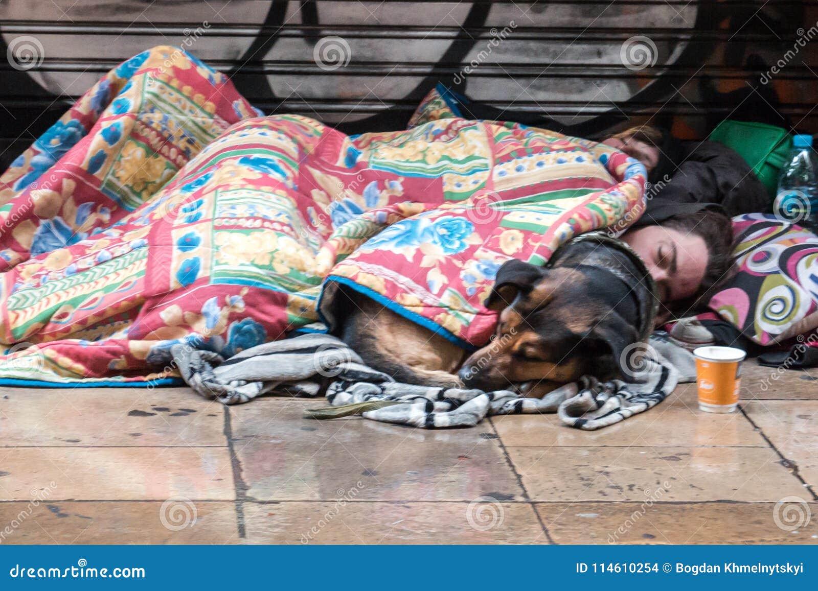 BARCELONA, SPAIN, February 4, 2018 A young homeless guy, a girl