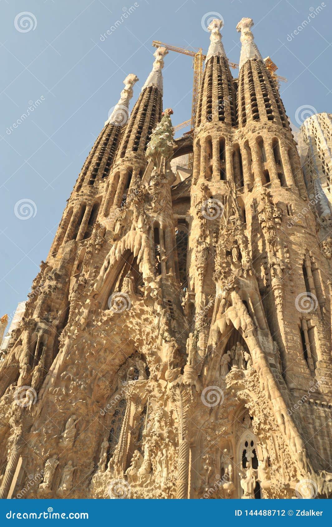 Barcelona, Spain - July 20, 2018 La Sagrada Familia, iconic landmark cathedral designed by Antoni Gaudi, build since 1882, bell t