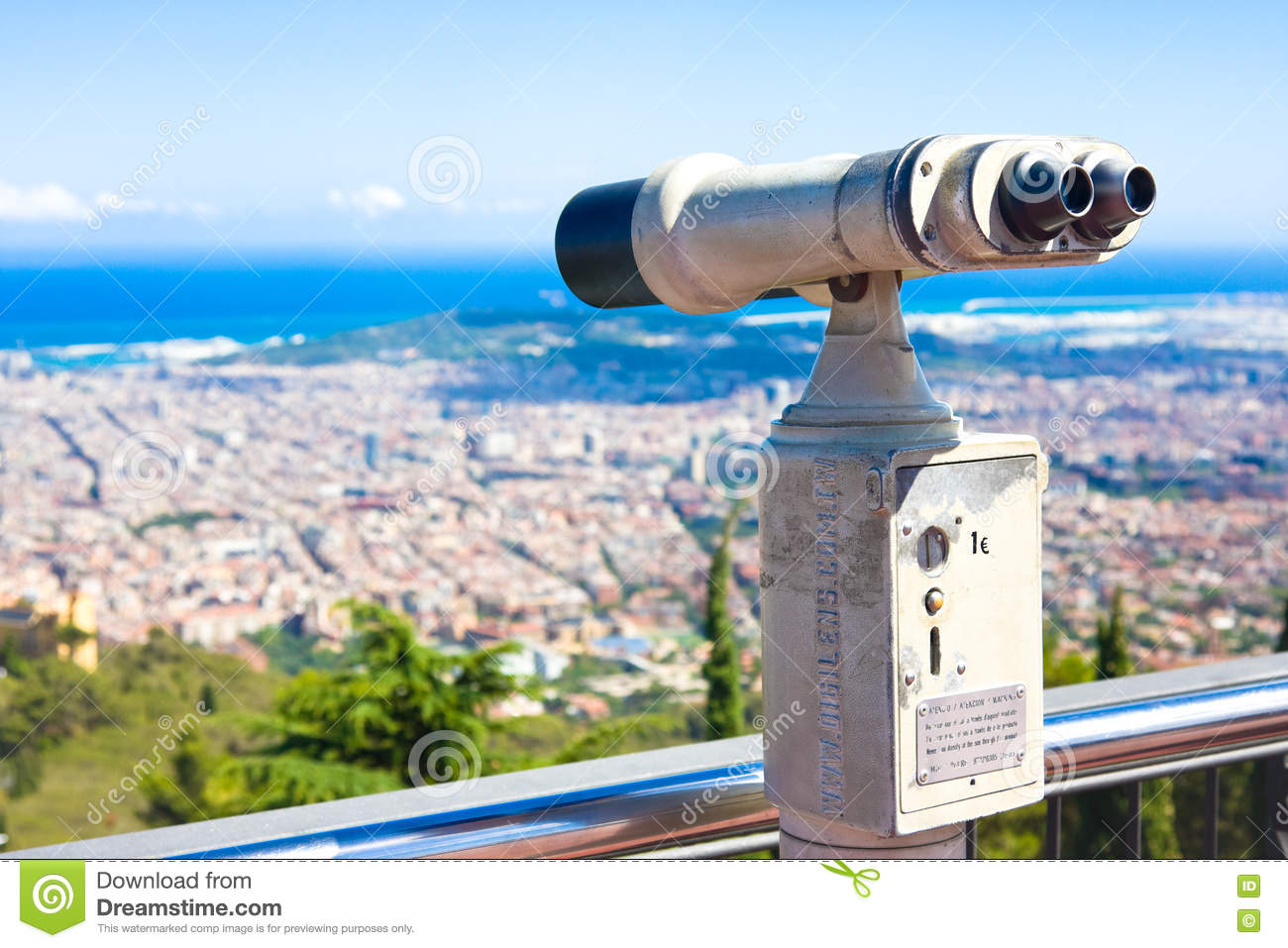 BARCELONA, SPAIN - JULY 13, 2016:Touristic telescope look at Barcelona, close up metal binoculars on background viewpoint overlook