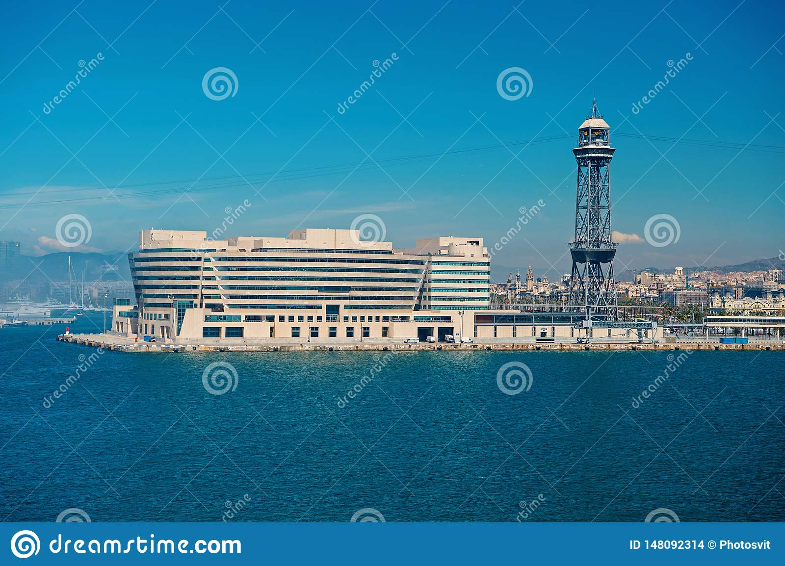 Barcelona, Spain - March 30, 2016: World Trade Center building and tower on blue sky. Business park. Trade and commerce