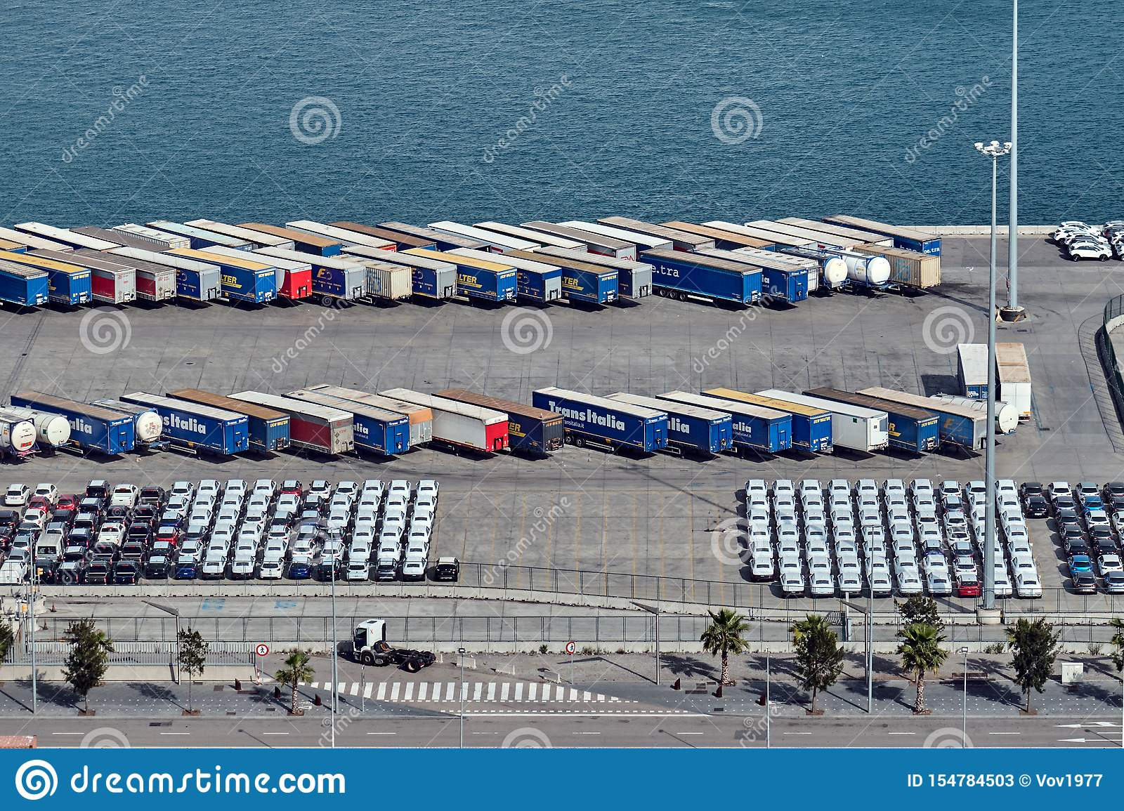 Barcelona, Spain - May, 27 2018: Cars, trucks and lorries parked at the Port of Barcelona