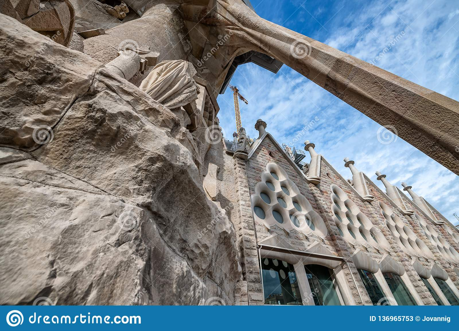 BARCELONA, SPAIN - MAY 14, 2018: Cathedral of La Sagrada Familia on a sunny spring day. It is designed by architect Antonio Gaudi