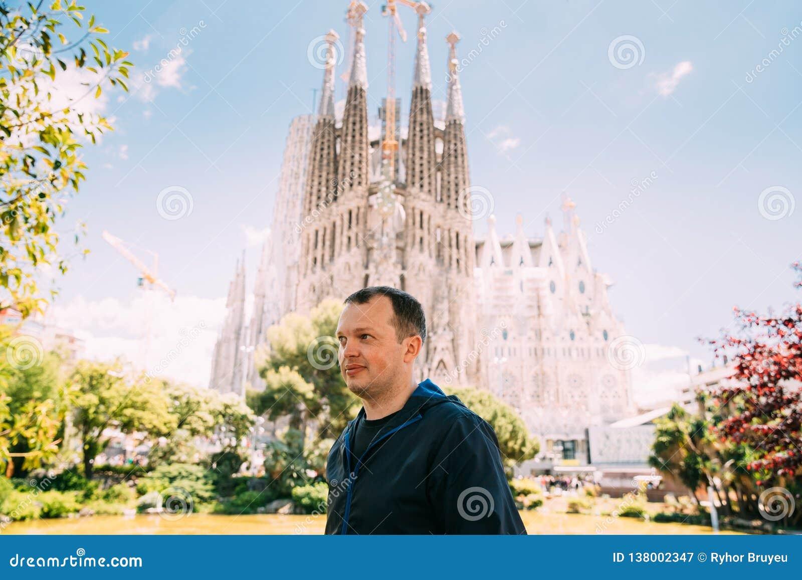 Barcelona, Spain. Portrait Of Caucasus Man On Background Basilica And Expiatory Church Of Holy Family Or Sagrada Familia