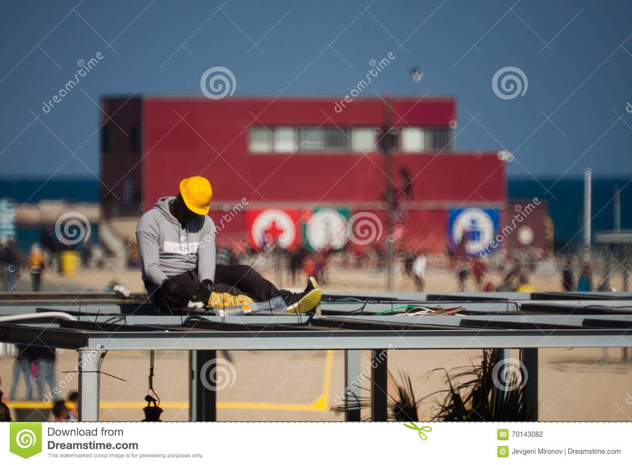 Barceloneta,Barcelona, Spain, March 2016: electrician work on a roof