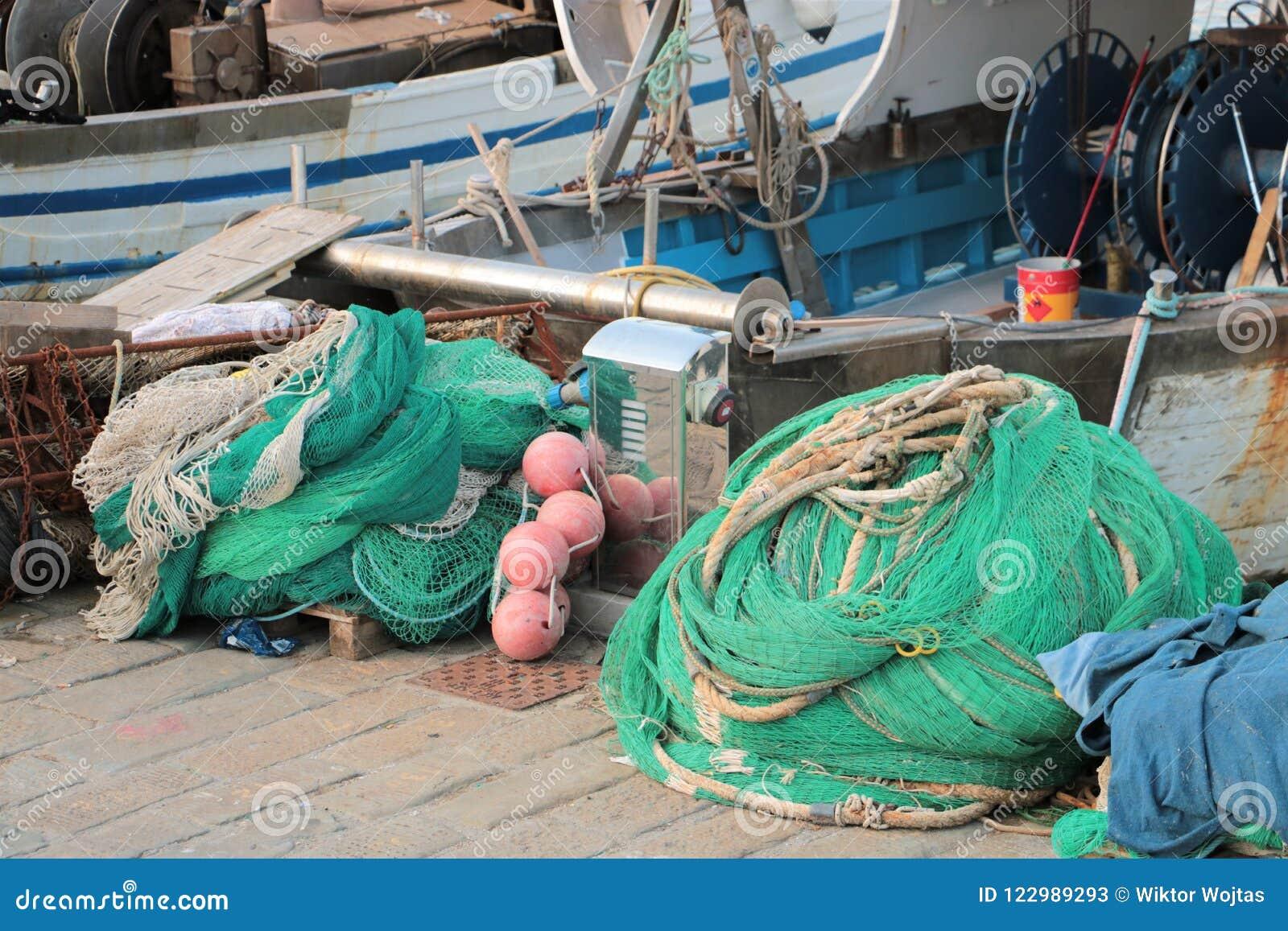 Barcos e redes de pesca