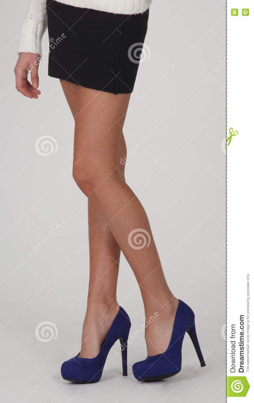 legs of in mini dress and high heel shoes