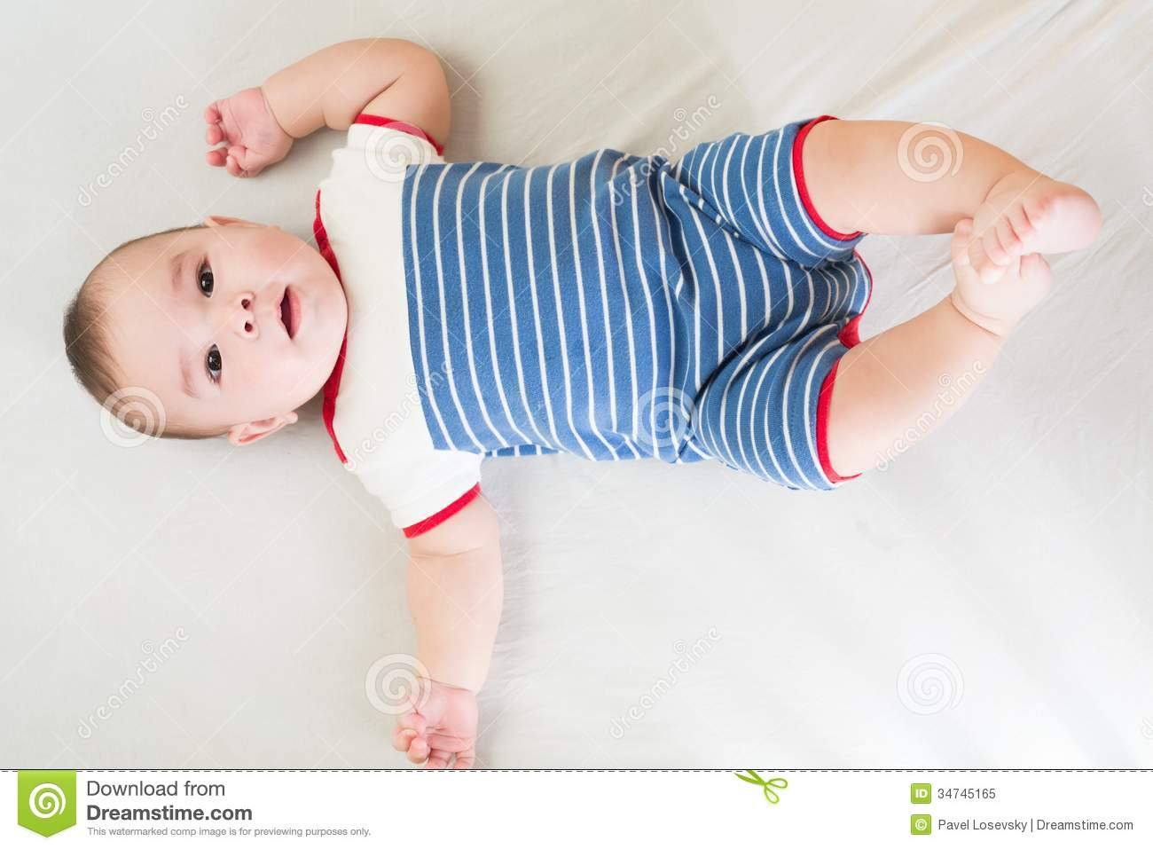 Download Barefoot Baby Boy In A Striped Dress Lies Stock Image - Image of elegant, beauty: 34745165