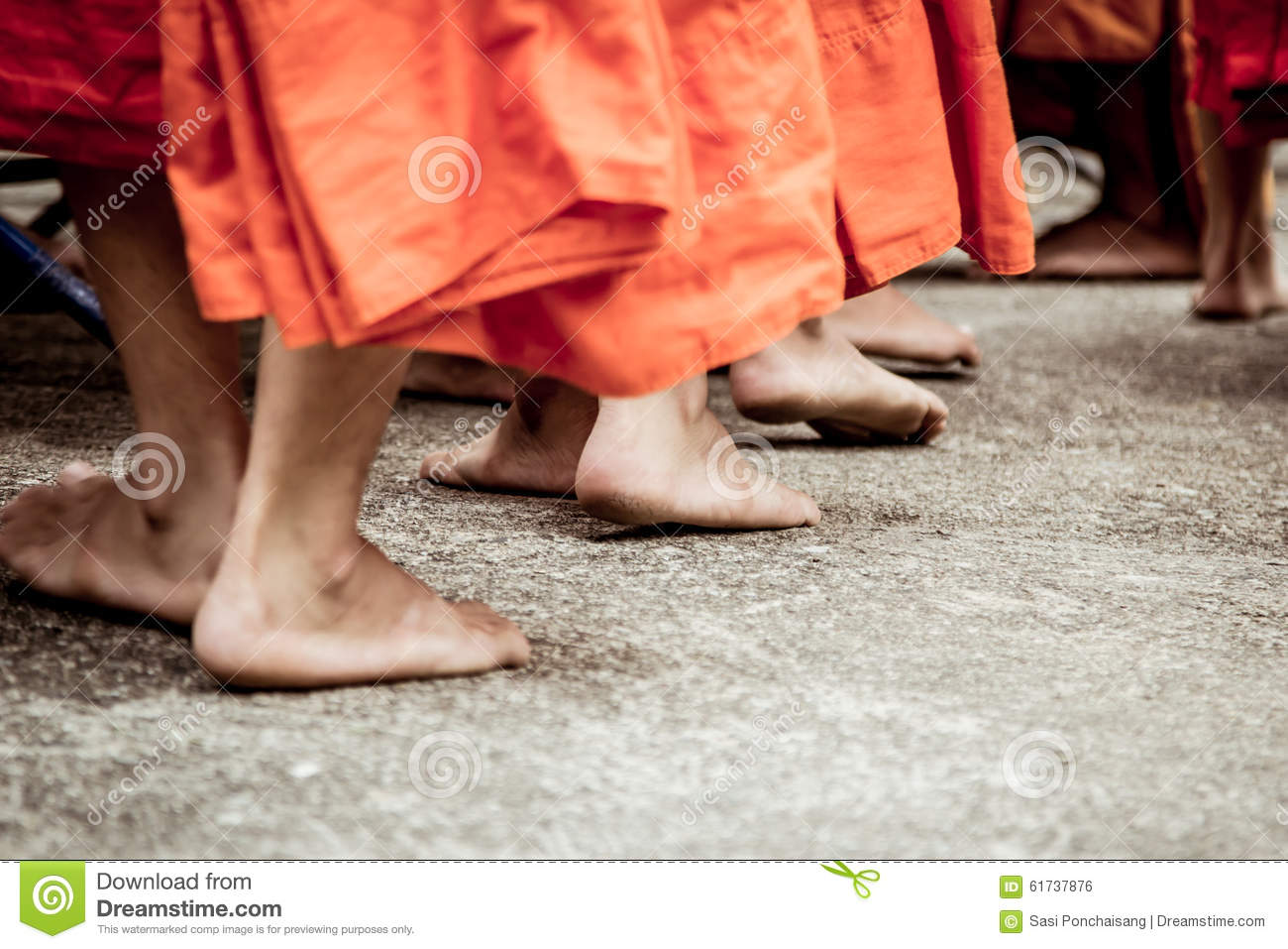 4a5aa46c88d8 Barefoot of Buddhist monk while stand in a row. Waiting people put food and  item
