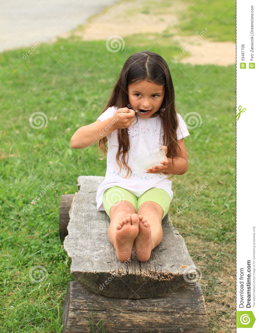 barefoot girl eating royalty free stock photos   image
