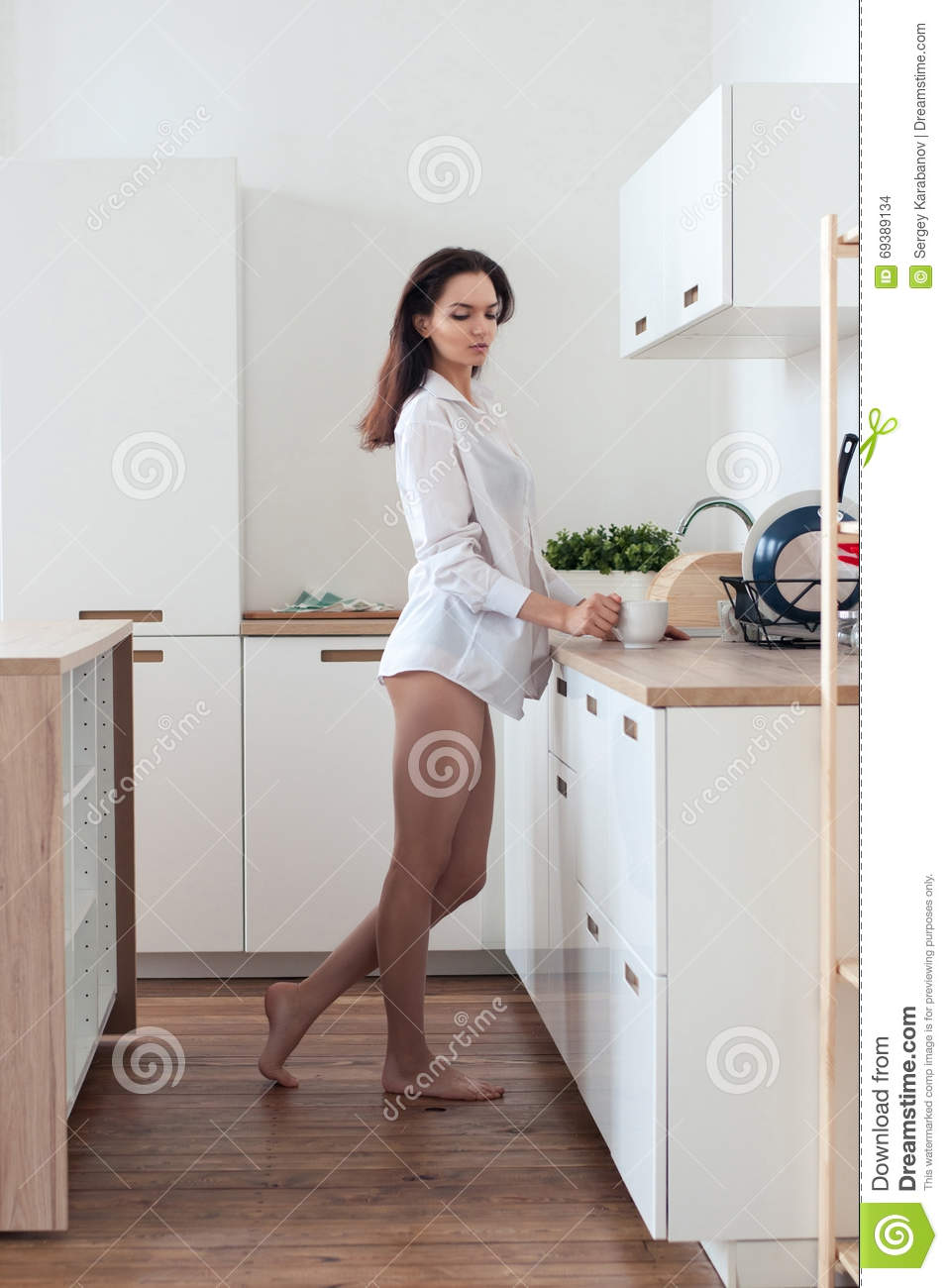 Barefoot Girl In Shirt Standing In The Kitchen Stock Photo - Image ...