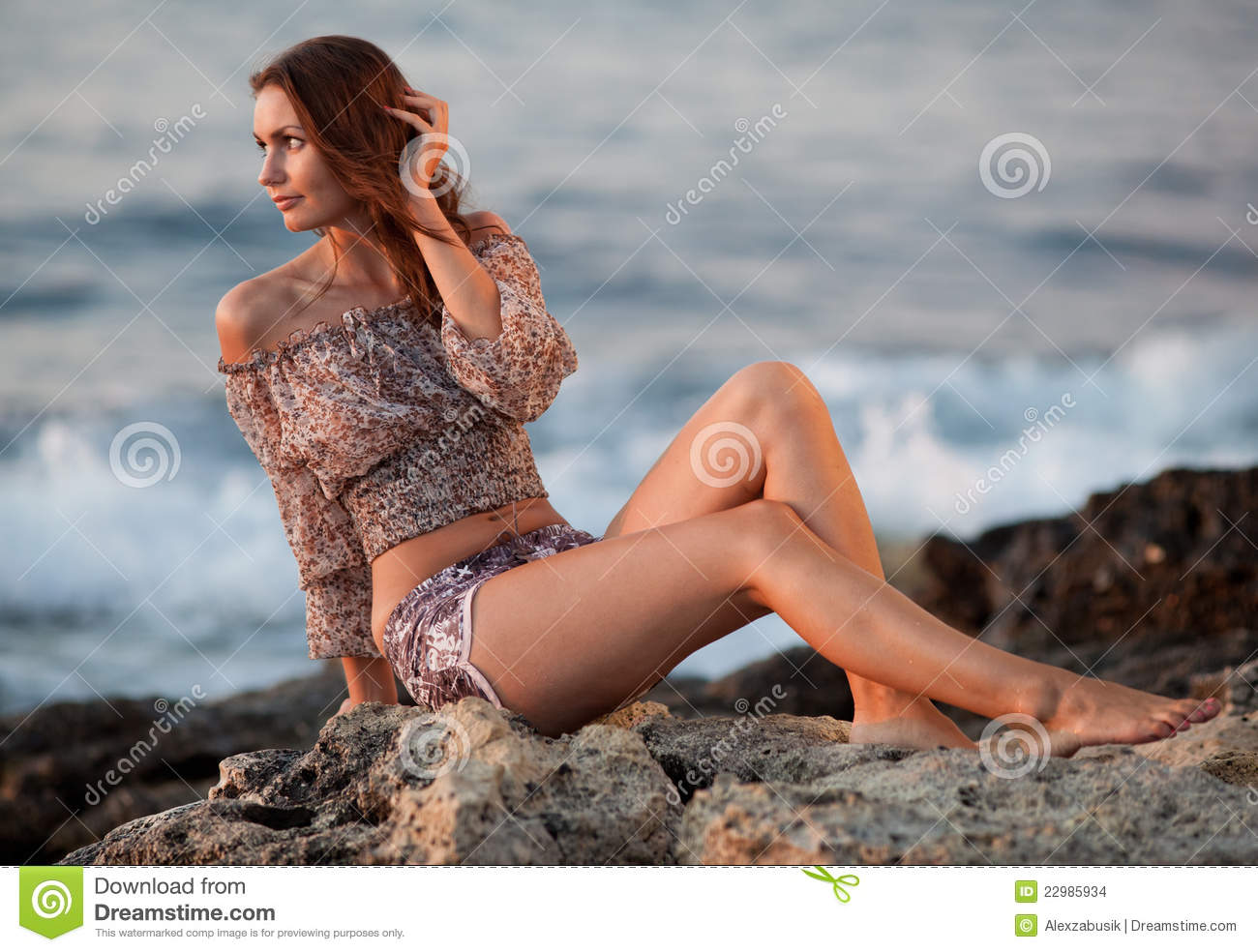 Girl sitting on rock mile without