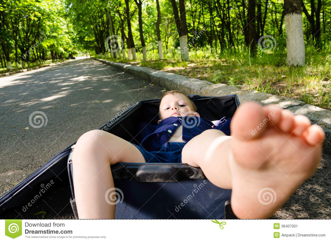 Barefoot Little Boy Inside A Suitcase Stock Image - Image: 36407001