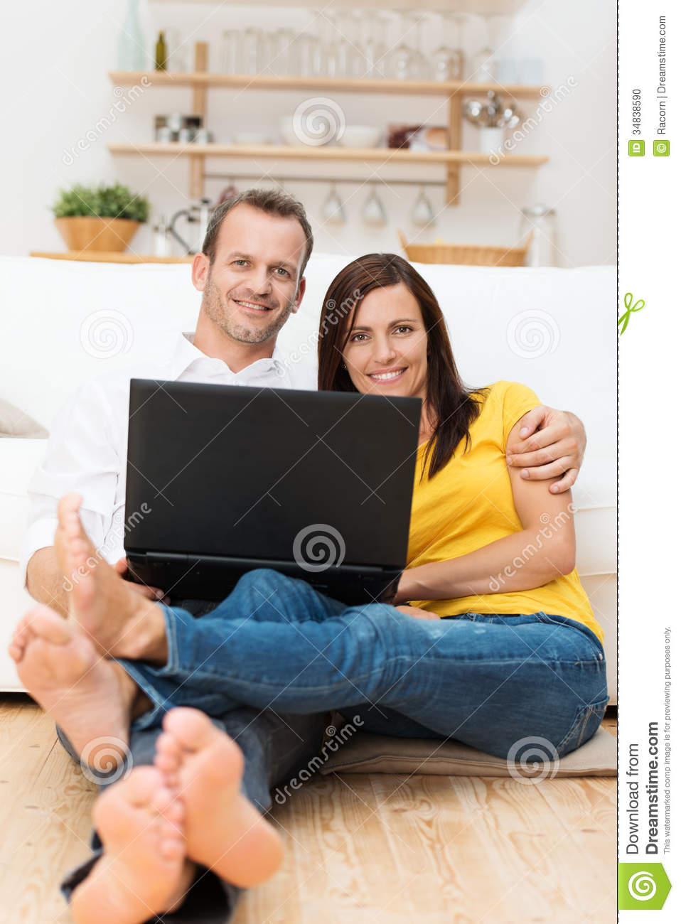 Stock Photo Barefoot Young Couple Relaxing Laptop Computer Sitting Wooden Floor Their Living Room Arm Arm Smiling Image34838590 on Floor Plan 3d Home Design