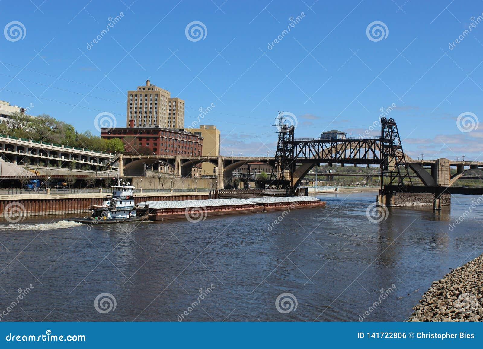 Barge On River Passing Under Lift Bridge Stock Photo - Image